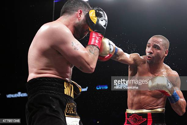 Andre Ward throws a right hook against Paul Smith during their Cruiserweight fight at ORACLE Arena on June 20 2015 in Oakland California