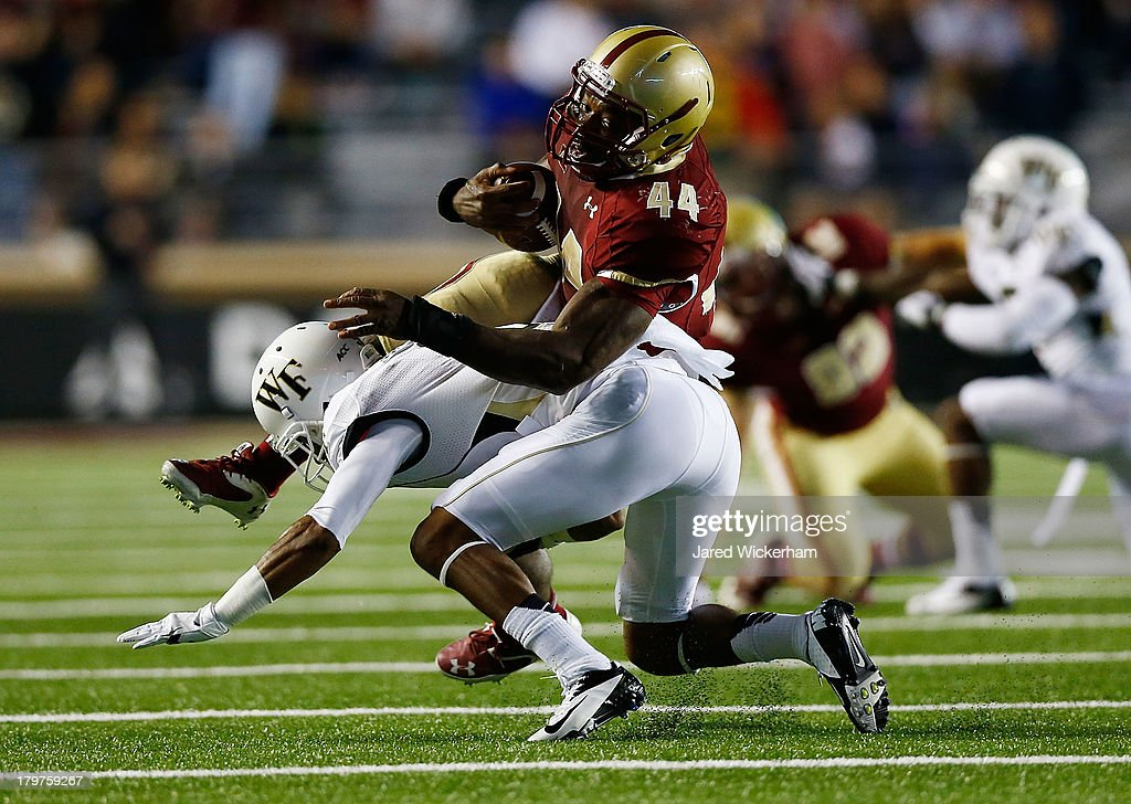 Andre Williams #44 of the Boston College Eagles is upended by a Wake Forest Demon Deacons defender in the second quarter during the game on September 6, 2013 at Alumni Stadium in Chestnut Hill, Massachusetts.
