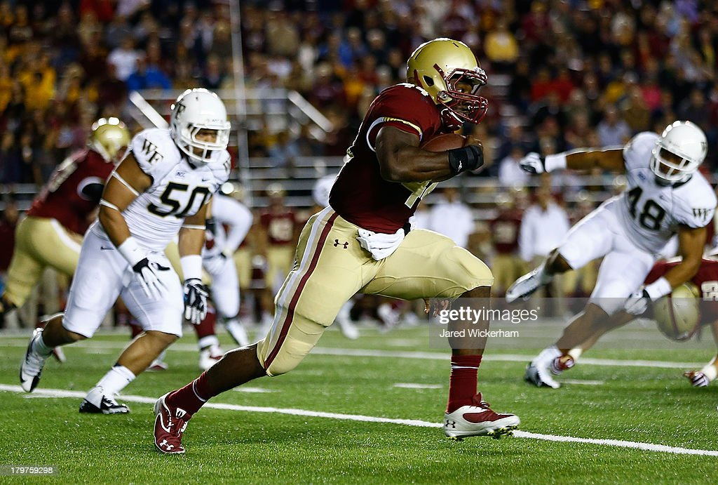 Andre Williams #44 of the Boston College Eagles runs with the ball against the Wake Forest Demon Deacons defense in the second quarter during the game on September 6, 2013 at Alumni Stadium in Chestnut Hill, Massachusetts.