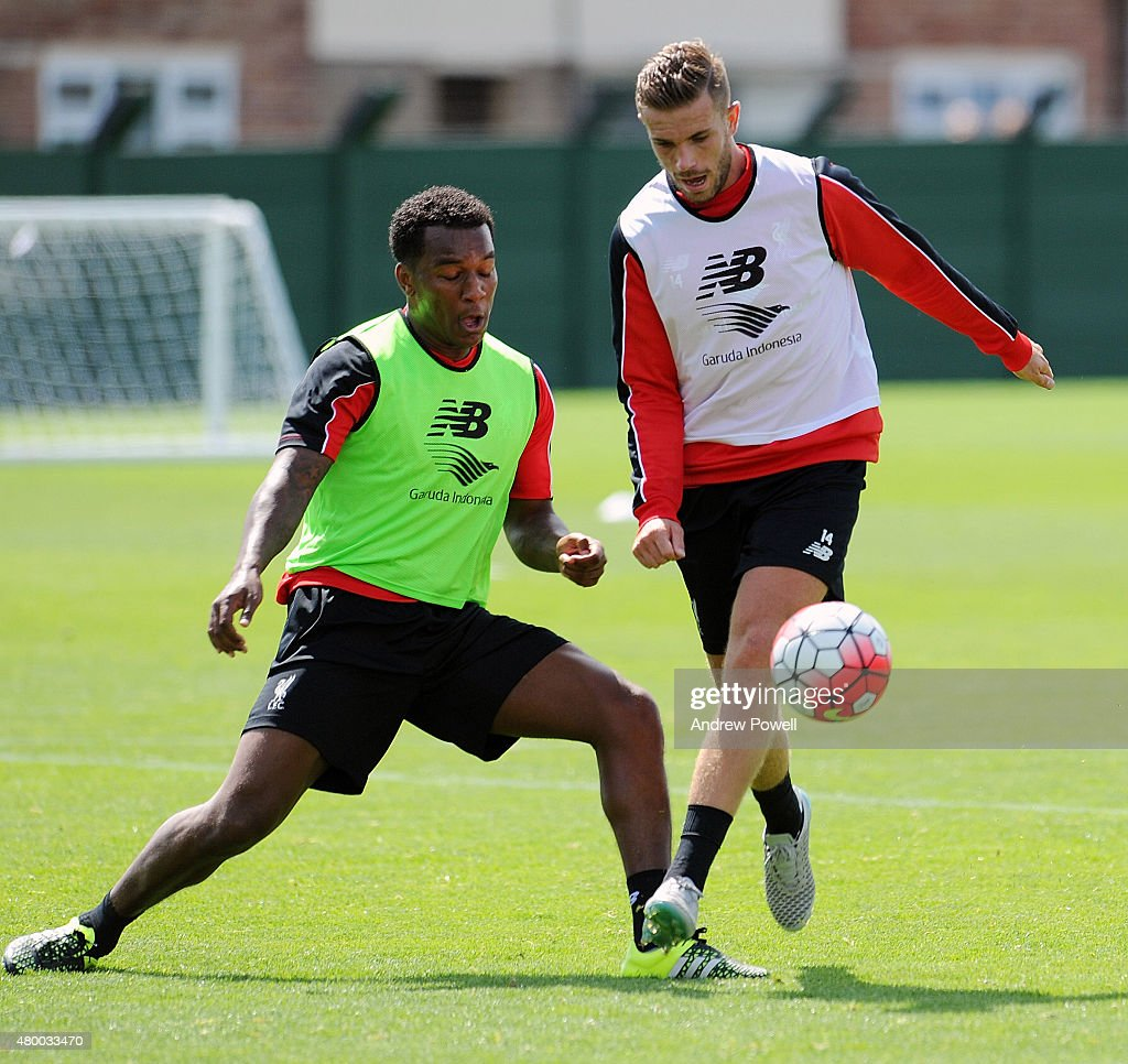 Andre Wisdom and Jordan Henderson of Liverpool during a training session at Melwood Training Ground on July 9, 2015 in Liverpool, England.