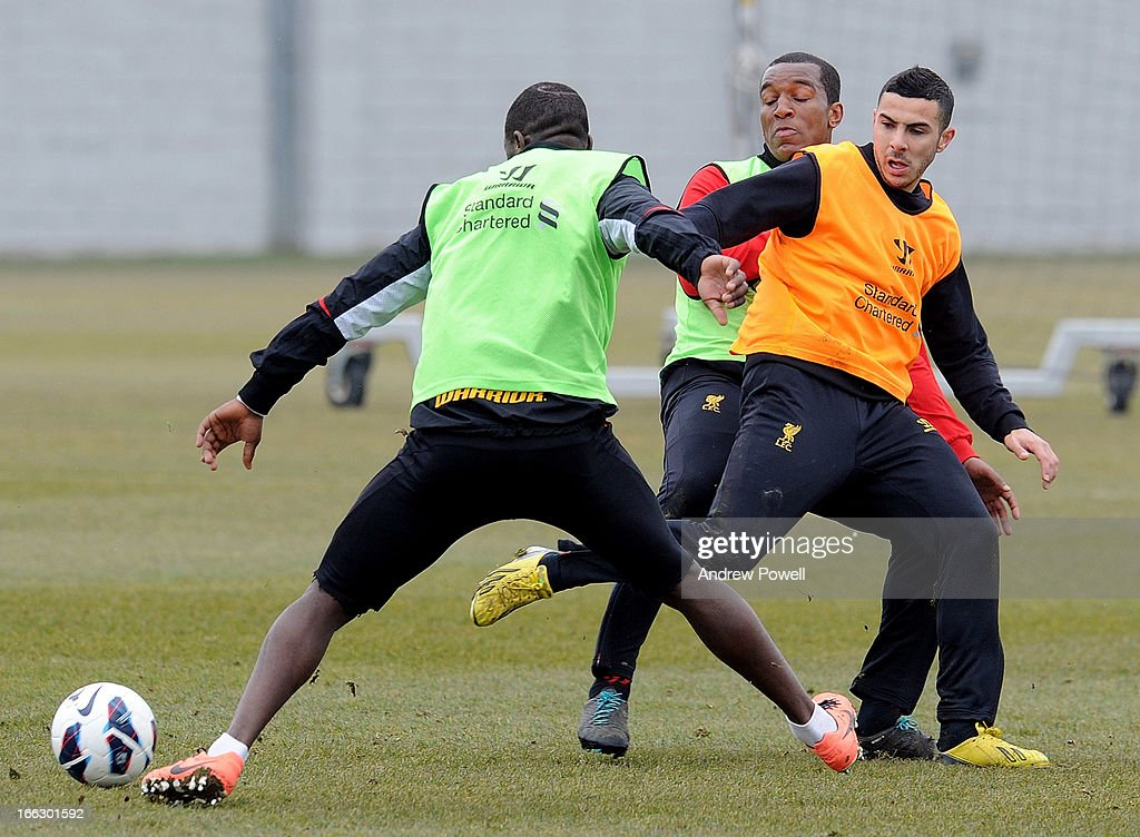 Andre Wisdom and <a gi-track='captionPersonalityLinkClicked' href=/galleries/search?phrase=Oussama+Assaidi&family=editorial&specificpeople=5909753 ng-click='$event.stopPropagation()'>Oussama Assaidi</a> of Liverpool in action during a training session at Melwood Training Ground on April 11, 2013 in Liverpool, England.