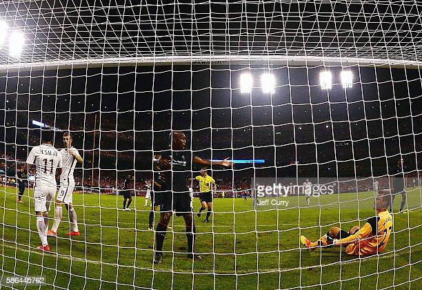 Andre Wisdom and Simon Mignolet of Liverpool FC react after giving up the game winning goal to Mohamed Salah of AS Roma during a friendly match at...