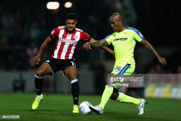 Andre Wisdom of Derby County and Ollie Watkins of Brentford in acrion during the Sky Bet Championship match between Brentford and Derby County at...