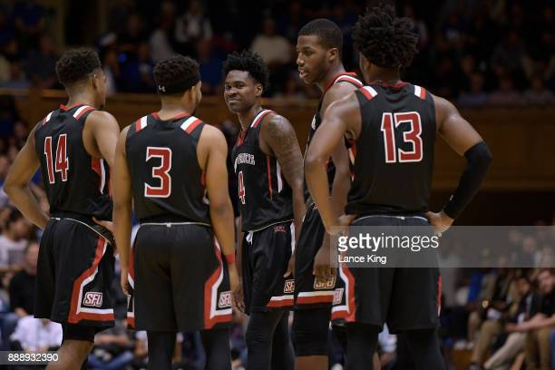 Andre Wolford Jamaal King Randall Gaskins Jr Daniel Wallace and Keith Braxton of the St Francis Red Flash huddle during their game against the Duke...