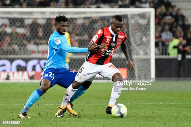 Andre Zambo Anguissa of Marseille and Jean Michael Seri of Nice during the Ligue 1 match between OGC Nice and Olympique Marseille at Allianz Riviera...