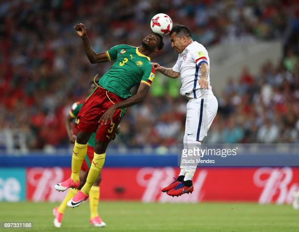 Andre Zambo of Cameroon and Gary Medel of Chile battle to win a header during the FIFA Confederations Cup Russia 2017 Group B match between Cameroon...