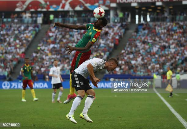 Andre Zambo of Cameroon and Joshua Kimmich of Germany battle for possession during the FIFA Confederations Cup Russia 2017 Group B match between...