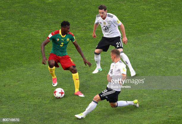 Andre Zambo of Cameroon is closed down by Sebastian Rudy and Joshua Kimmich of Germany during the FIFA Confederations Cup Russia 2017 Group B match...