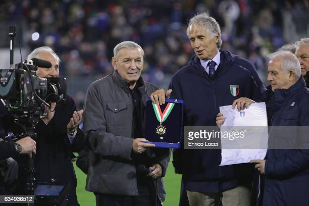 Andrea Abodi president of CON rewards Gigi Riva bank with the golden collar during the Serie A match between Cagliari Calcio and Juventus FC at...