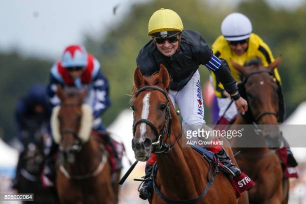 Andrea Atzeni celebrates after riding Stradivarius to win The Qatar Goodwood Cup series from Big Orange on day one of the Qatar Goodwood Festival at...