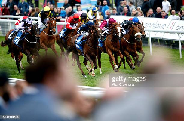 Andrea Atzeni riding Discreet Hero win The Ralph Raper Memorial Stakes at York racecourse on May 13 2016 in York England