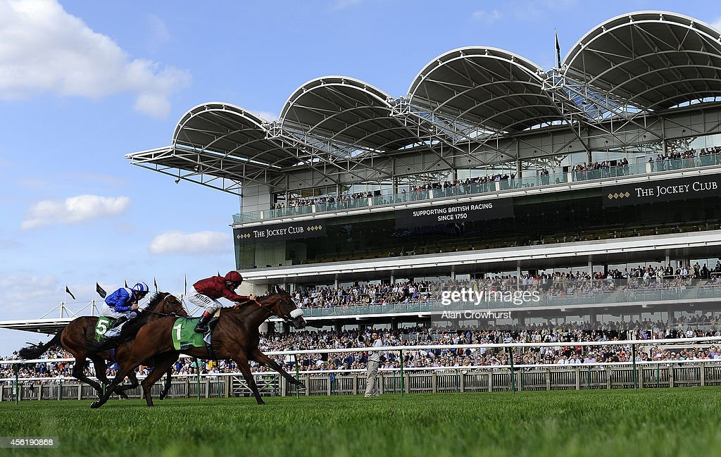 Andrea Atzeni riding Elm Park win The Juddmonte Royal Lodge Stakes at Newmarket racecourse on September 27 2014 in Newmarket England