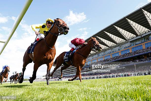 Andrea Atzeni riding Postponed win The King George VI And Queen Elizabeth Stakes from Eagle Top and Frankie Dettori at Ascot racecourse on July 25...