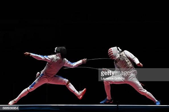 Andrea Baldini of Italy competes against Gerek Meinhardt of the United States during the Men's Foil Team Bronze Medal Match bout on Day 7 of the Rio...