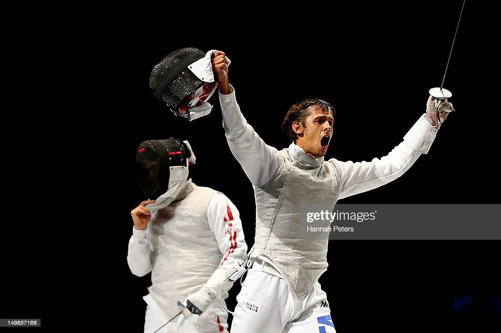 <a gi-track='captionPersonalityLinkClicked' href=/galleries/search?phrase=Andrea+Baldini&family=editorial&specificpeople=2205607 ng-click='$event.stopPropagation()'>Andrea Baldini</a> (R)of Italy reacts while competing against <a gi-track='captionPersonalityLinkClicked' href=/galleries/search?phrase=Kenta+Chida&family=editorial&specificpeople=4073098 ng-click='$event.stopPropagation()'>Kenta Chida</a> (L) of Japan in the gold medal match of the Men's Foil Team Fencing finals on Day 9 of the London 2012 Olympic Games at ExCeL on August 5, 2012 in London, England.