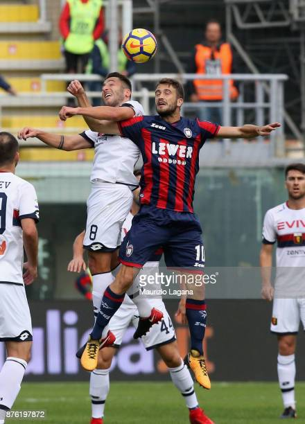 Andrea Barberis of Crotone competes for the ball in air with Andrea Bertolacci of Genoa during the Serie A match between FC Crotone and Genoa CFC at...