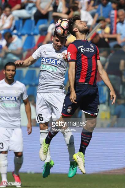 Andrea Barberis of Crotone competes for the ball in air with Sven Kums of Udinese during the Serie A match between FC Crotone and Udinese Calcio at...