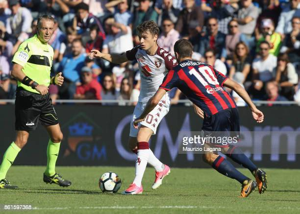 Andrea Barberis of Crotone competes for the ball with Adem Ljajic of Torino during the Serie A match between FC Crotone and Torino FC at Stadio...