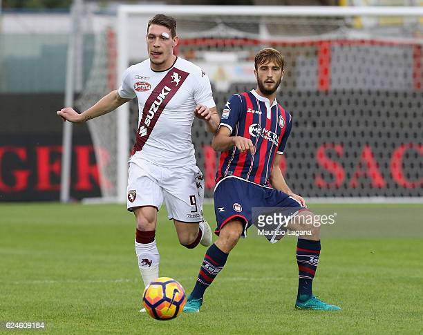 Andrea Barberis of Crotone competes for the ball with Andrea Belotti of Torino during the Serie A match between FC Crotone and FC Torino at Stadio...