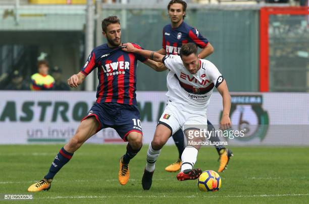 Andrea Barberis of Crotone competes for the ball with Andrea Bertolacci of Genoa during the Serie A match between FC Crotone and Genoa CFC at Stadio...