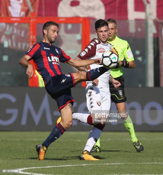 Andrea Barberis of Crotone competes for the ball with Daniele Baselli of Torino during the Serie A match between FC Crotone and Torino FC at Stadio...