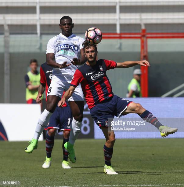 Andrea Barberis of Crotone competes for the ball with Duvan Zapata of Udinese during the Serie A match between FC Crotone and Udinese Calcio at...