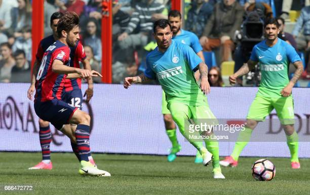 Andrea Barberis of Crotone competes for the ball with Gary Medel of Inter during the Serie A match between FC Crotone and FC Internazionale at Stadio...