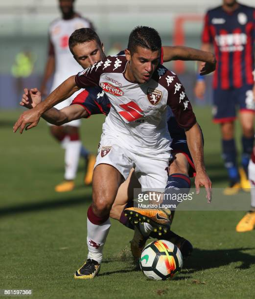 Andrea Barberis of Crotone competes for the ball with Iago Falque of Torino during the Serie A match between FC Crotone and Torino FC at Stadio...