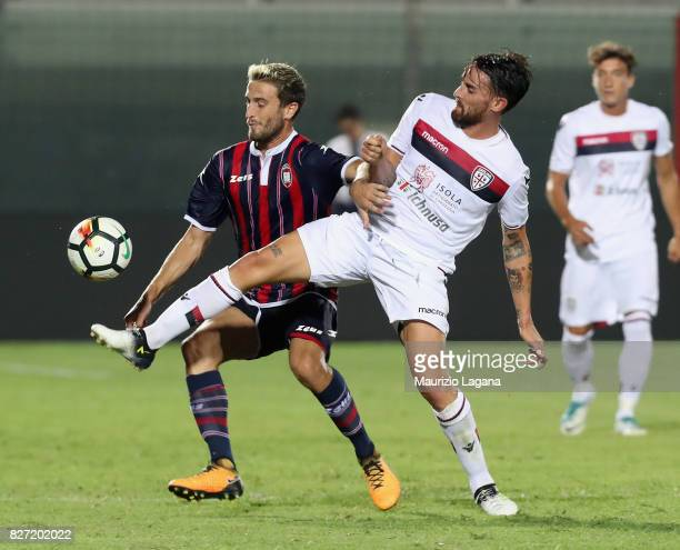 Andrea Barberis of Crotone competes for the ball with Luca Cigarini of Cagliari during the PreSeason Friendly match between FC Crotone and Cagliari...