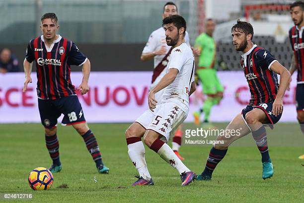 Andrea Barberis of Crotone competes for the ball with Marco Benassi of Torino during the Serie A match between FC Crotone and FC Torino at Stadio...