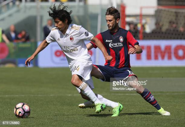 Andrea Barberis of Crotone competes for the ball with Matias Fernandez of Milan during the Serie A match between FC Crotone and AC Milan at Stadio...