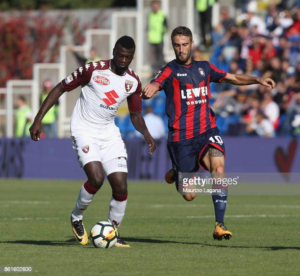 Andrea Barberis of Crotone competes for the ball with M'Baye Niang of Torino during the Serie A match between FC Crotone and Torino FC at Stadio...