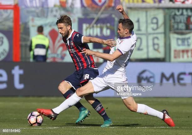 Andrea Barberis of Crotone competes for the ball with Milan Badelj of Fiorentina during the Serie A match between FC Crotone and ACF Fiorentina at...