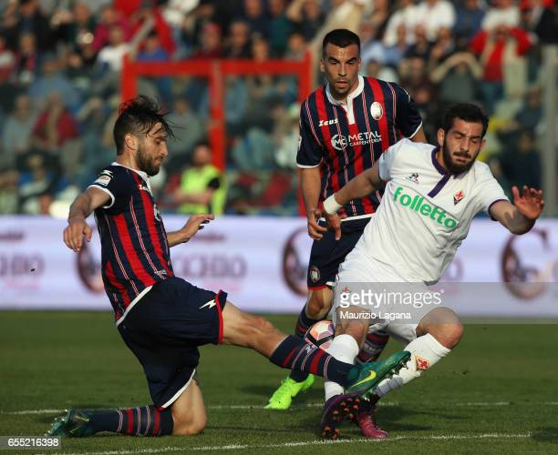 Andrea Barberis of Crotone competes for the ball with Riccardo Saponara of Fiorentina during the Serie A match between FC Crotone and ACF Fiorentina...