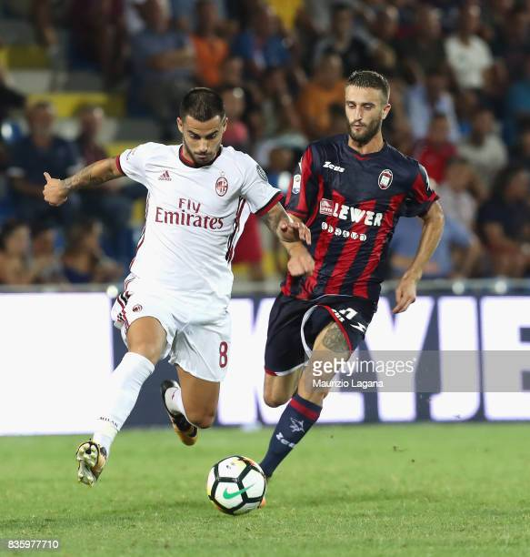 Andrea Barberis of Crotone competes for the ball with Suso of Milan during the Serie A match between FC Crotone and AC Milan on August 20 2017 in...