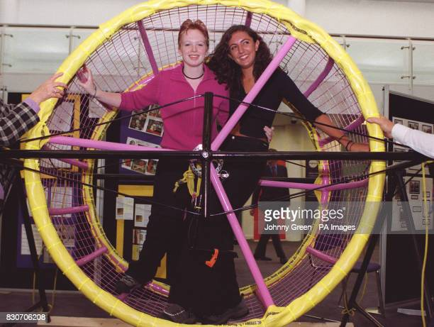 Andrea Barden from Leeds and Natasha Rostegar from Guiseley in West Yorkshire demonstrate their giant 5ft high hamster wheel invention which gained...
