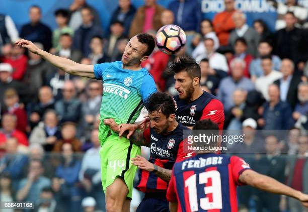 Andrea Bareberis of Crotone competes for the ball with Ivan Perisic of Inter during the Serie A match between FC Crotone and FC Internazionale at...