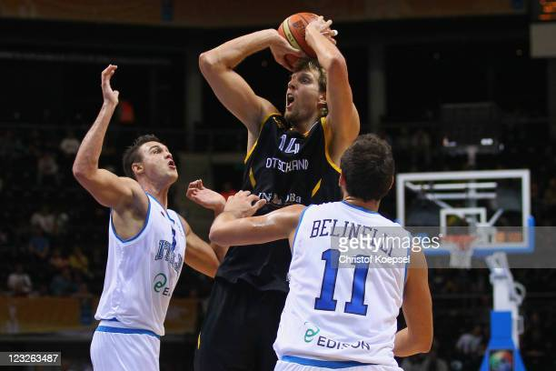Andrea Bargnani and Marco Belinelli of Italy defend against Dirk Nowitzki of Germany the EuroBasket 2011 first round group B match between Italy and...