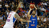 Andrea Bargnani of Italy drives to the basket against Miroslav Raduljica of Serbia during the FIBA EuroBasket 2015 Group B basketball match between...