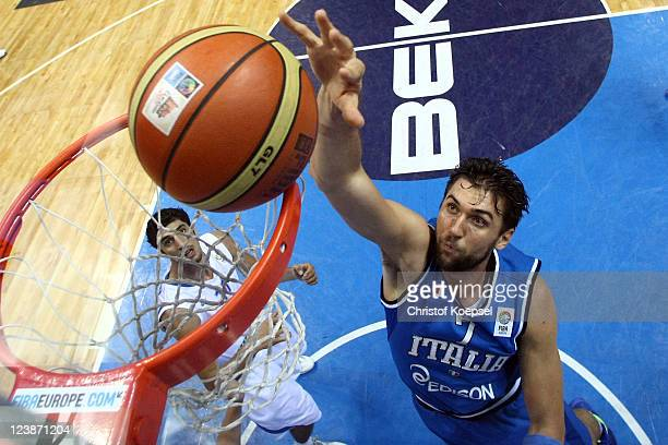 Andrea Bargnani of Italy dunskt he ball and Lior Eliyahu of Israel watches him during the EuroBasket 2011 first round group B match between Israel...