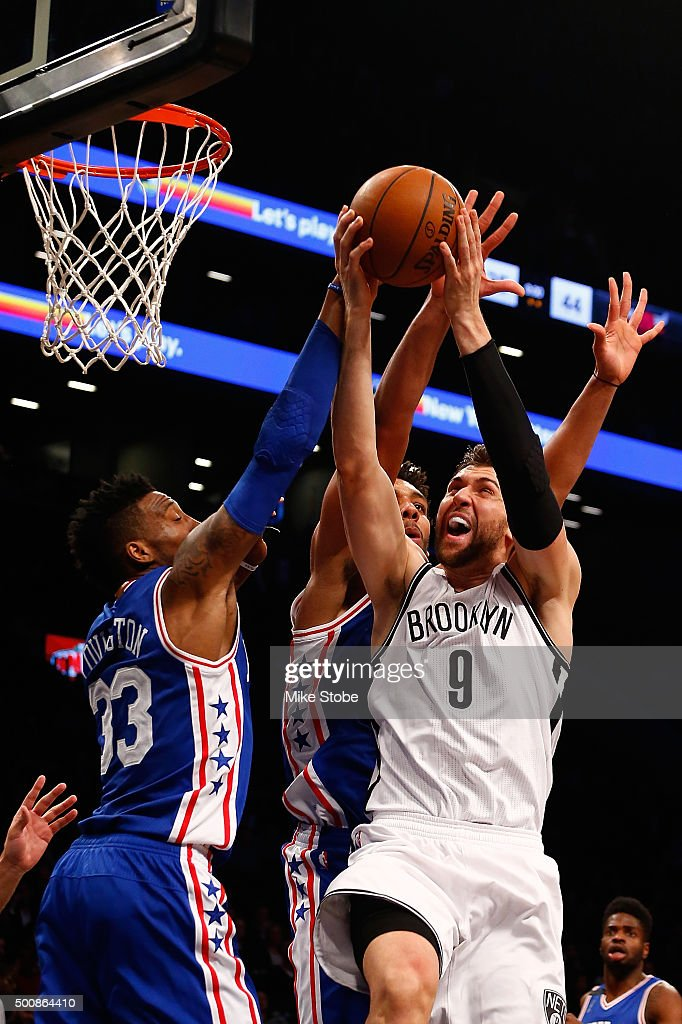 Andrea Bargnani #9 of the Brooklyn Nets drives to the net against Robert Covington #33 of the Philadelphia 76ers at Barclays Center on December 10, 2015 in Brooklyn borough of New York City.