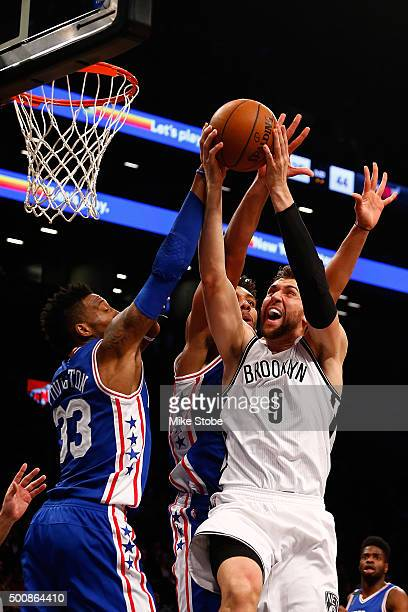 Andrea Bargnani of the Brooklyn Nets drives to the net against Robert Covington of the Philadelphia 76ers at Barclays Center on December 10 2015 in...
