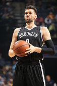 Andrea Bargnani of the Brooklyn Nets shoots a free throw against the Memphis Grizzlies on October 31 2015 at FedExForum in Memphis Tennessee NOTE TO...