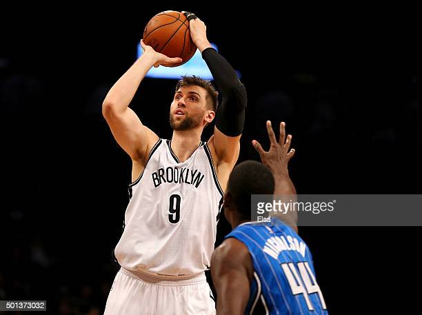 Andrea Bargnani of the Brooklyn Nets takes a shot as Andrew Nicholson of the Orlando Magic defends at Barclays Center on December 14 2015 in the...