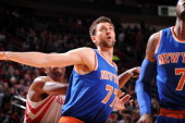 Andrea Bargnani of the New York Knicks battles for the rebound against the Houston Rockets on January 3 2014 at the Toyota Center in Houston Texas...