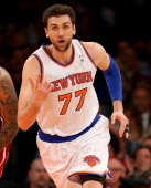Andrea Bargnani of the New York Knicks celebrates his basket in the first half against the Miami Heat at Madison Square Garden on January 9 2014 in...