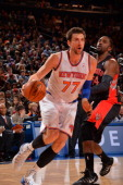 Andrea Bargnani of the New York Knicks drives against the Toronto Raptors on December 27 2013 at Madison Square Garden in New York City New York NOTE...