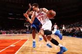 Andrea Bargnani of the New York Knicks drives past DeAndre Jordan of the Los Angeles Clippers during a game at Madison Square Garden in New York City...