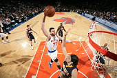 Andrea Bargnani of the New York Knicks goes to the basket against Luis Scola of the Indiana Pacers on March 7 2015 at Madison Square Garden in New...