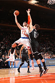 Andrea Bargnani of the New York Knicks goes to the basket against Brook Lopez of the Brooklyn Nets on April 1 2015 at Madison Square Garden in New...